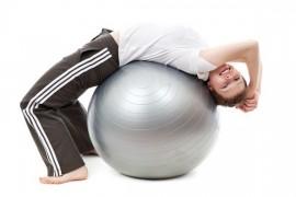 Relieve stiff back through gymnastic ball
